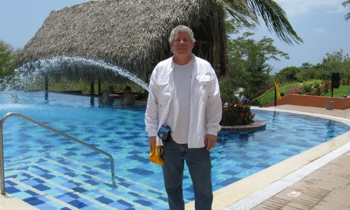 Me enjoying the resort - plenty of big pools an private, kayaking off the beach, all the food you could eat...