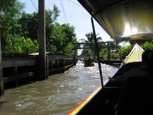 Longboat ride thru canals to the Floating Market