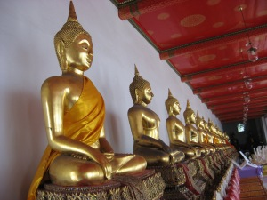Gold Sitting Buddhas - the king collected these from all over Thailand and brought to main temple for protection and display