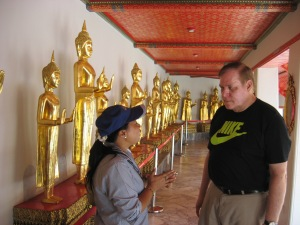 Tour guide Mina explains to Steve that the Buddha has 3 positions, standing, sitting and reclining.