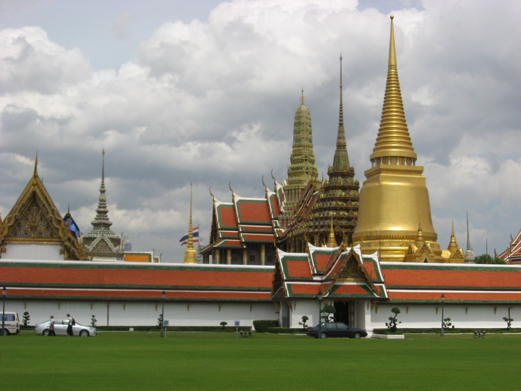 Wat Phra Kaeo temple complex - gold tower contains Buddha's breastbone, 2nd tower is a Buddhist library, 3rd tower contains a life-size emerald Buddha