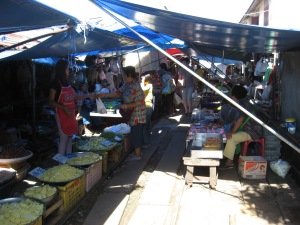 Under the awnings of the train market