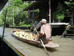 Going to market with his coconuts.