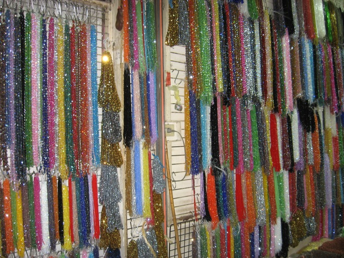 strung necklace beads in market store