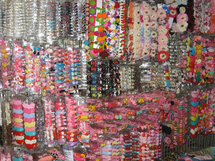 Girl barrettes covering the wall of a store in one of the many Bangkok markets