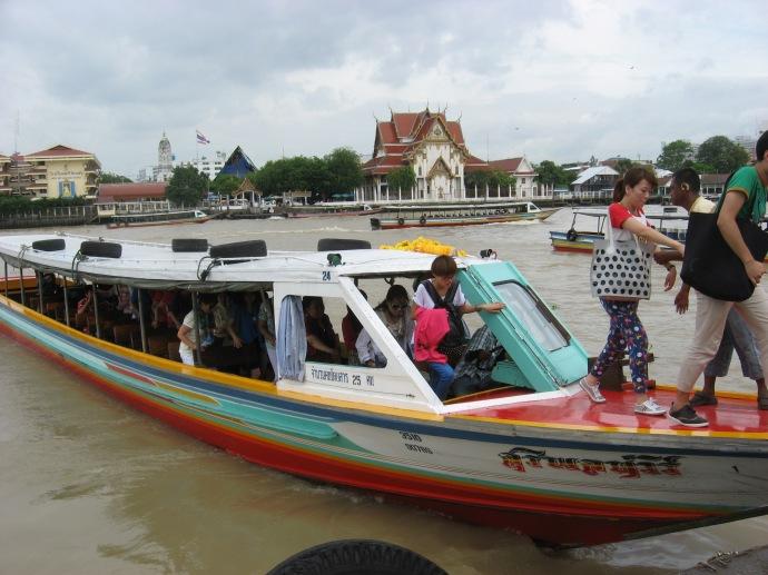 Tourist group boats on river thru Bangkok