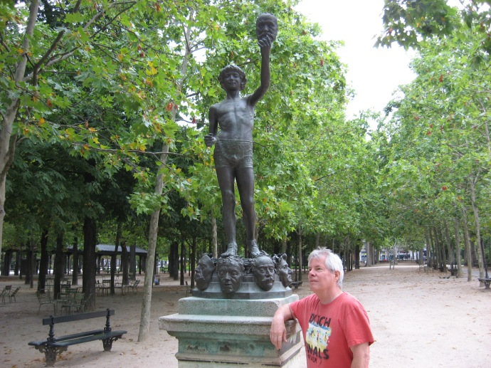 Me posing next to my favorite statue in Paris - the mask seller in the Jardin de Luxembourg