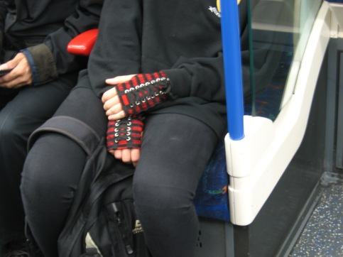 Hand shoes a girl was wearing on the Underground
