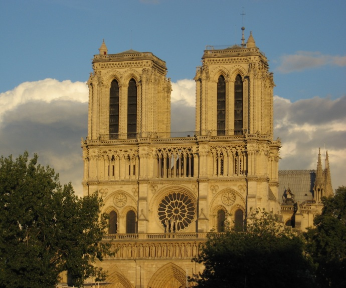 Notre Dame Cathedral at the city's heart - evening light turning it a butter color - construction started in 1163 - finished 200 years later. Wonderful stain glass windows.