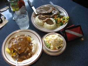 The bottom dish is a local favorite, Loco Moco - hamburger patty with two eggs on bed of rice covered with gravy
