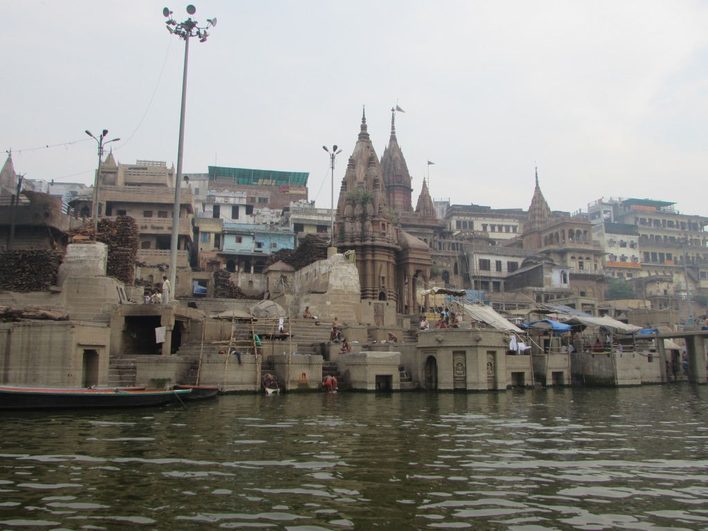 The holy Ganges river flows through Varanasi. Every day thousands of pilgrims and locals ritually bathe in the (polluted) water, for whatever blessing this will bring to them.