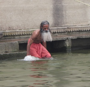 Holy man doing ritual bath in the Ganges. Scientists have tested the water and say it has a noticeable radiation from the minerals in the Himalayas.