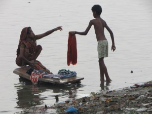Washing clothes by hand in the river
