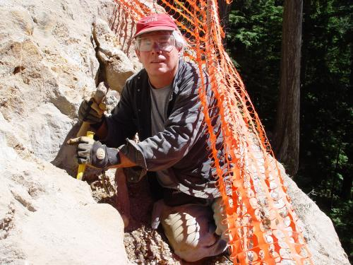 Me chiseling quartz crystals and large fool's gold cubes on Spruce Mountain near Seattle