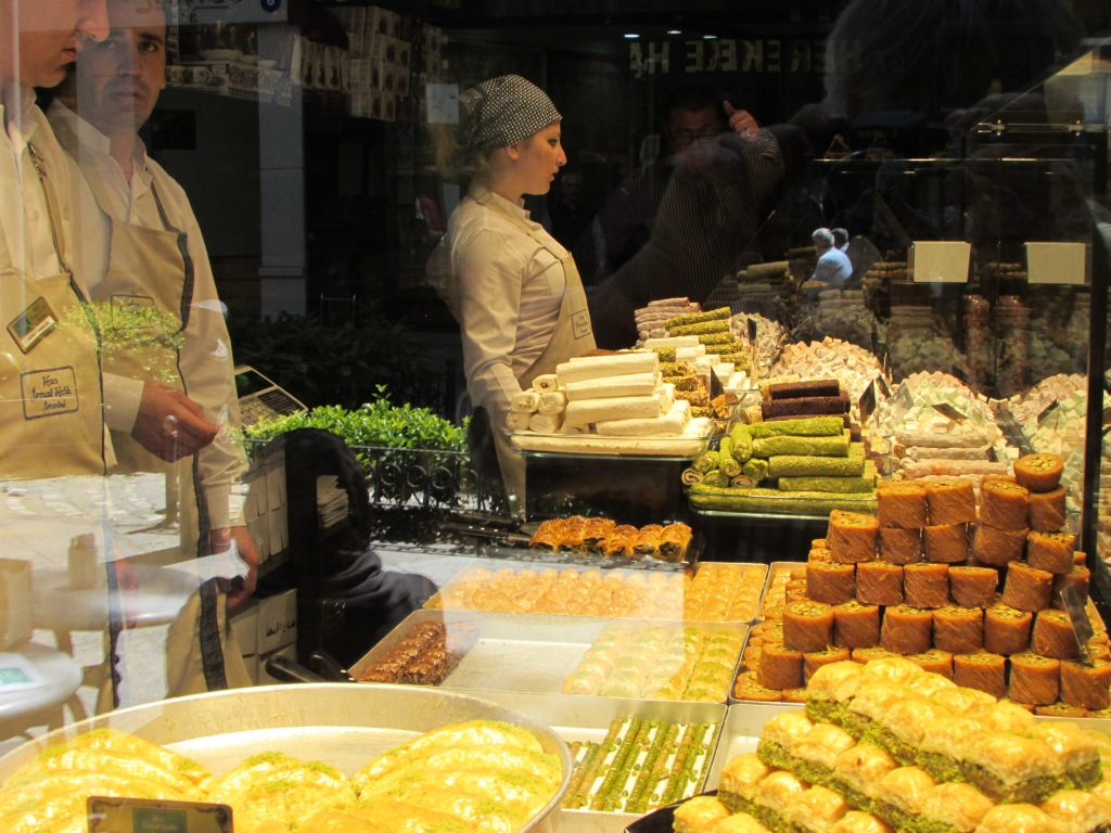Girl selling baklava and Turkish Delight in Grand Bazaar
