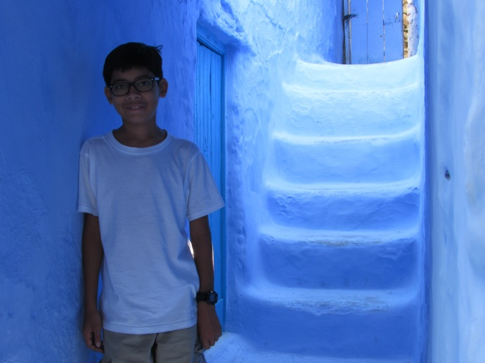 My grandson Andrew in doorway at Blue Pearl City (Chefchaouen) in north of Morocco