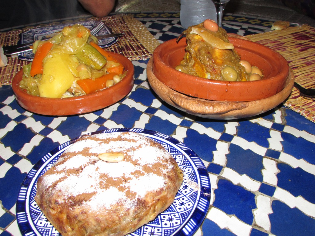 Chicken pie (with cinnamon and powdered sugar, a seven vegetable tajine and a lemon chicken dish. Typical Moroccan food offered by most good restaurants, along with couscous.