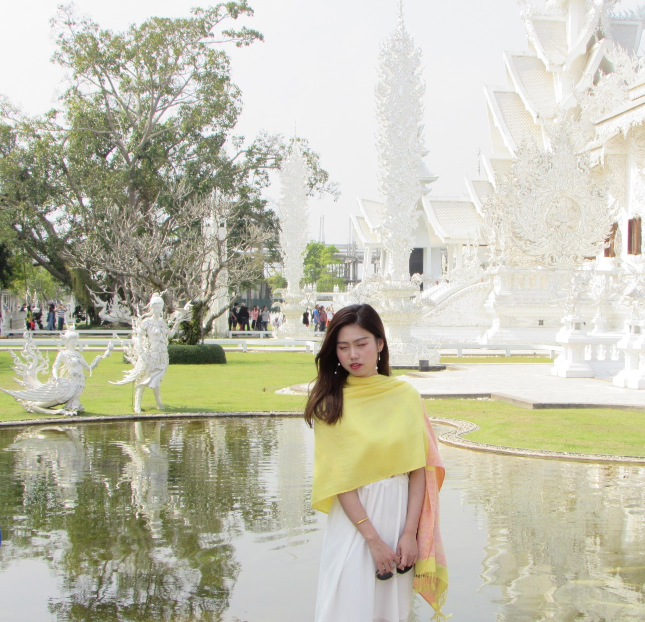yellow girl white temple Chiang Rai
